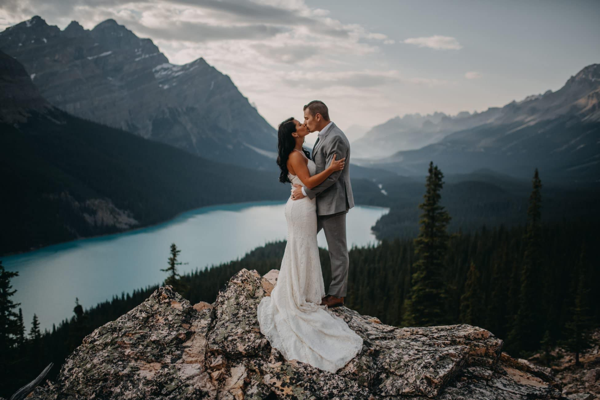 bride and groom kissing at Peyto Lake as they elope in banff photographed by Calgary intimate wedding photographer