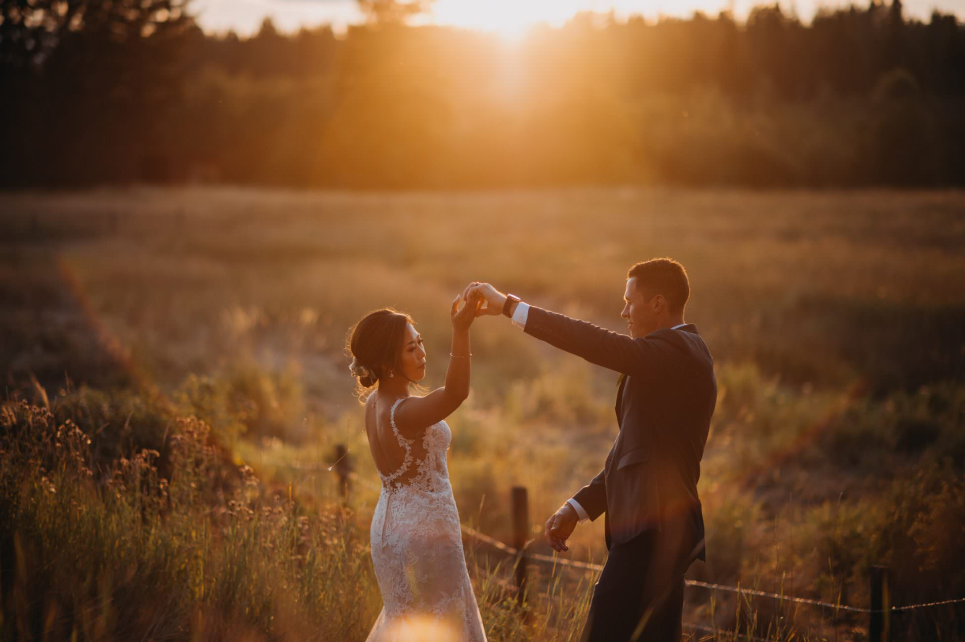 bride and groom dancing at sunset at Cherry Creek Estates photographed by Calgary intimate wedding photographer