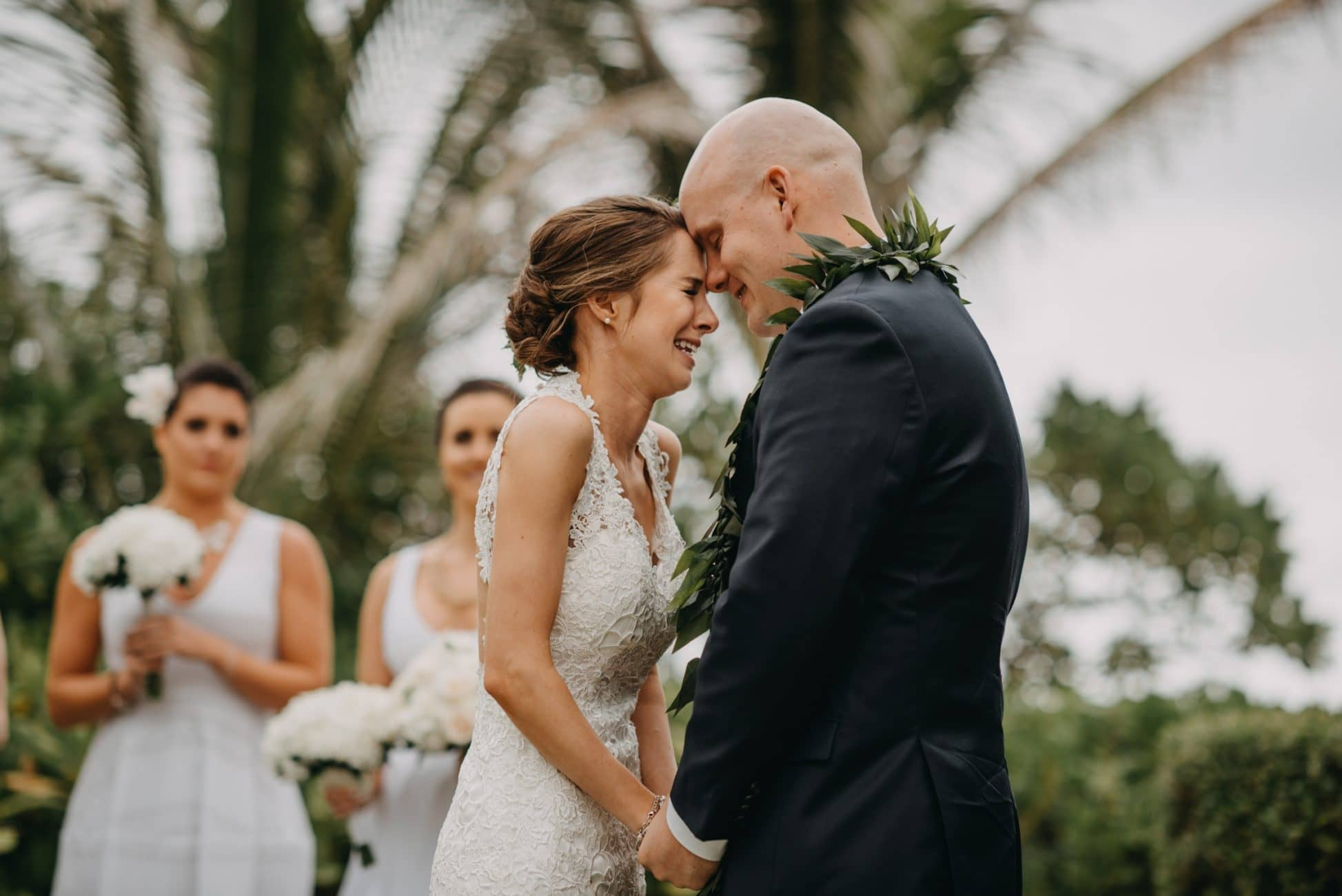 bride and groom crying during vows in Kauai photographed by Calgary intimate wedding photographer